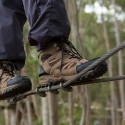 Hiker foot walking on zip line cable in the forest